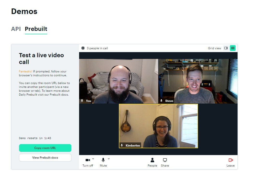 Three participants on a video call embedded in a website under a Demos section
